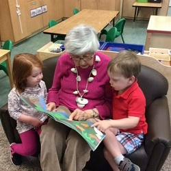 Senior Reading to a Child at Westminster Canterbury Richmond in Richmond, VA