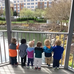 Children looking at the pond at Westminster Canterbury Richmond in Richmond, VAL